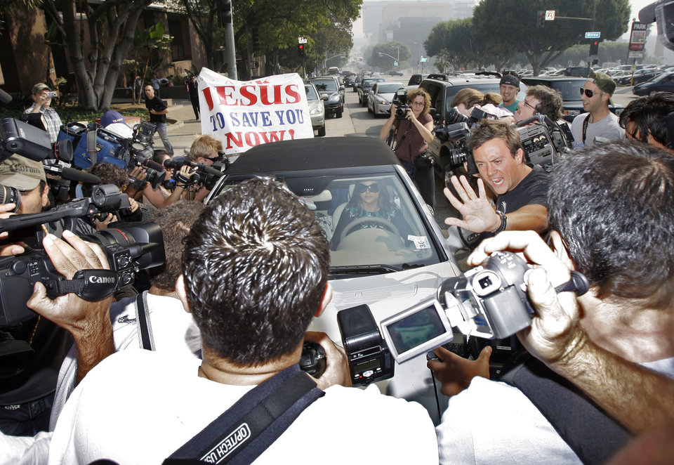 Photo - File-This Oct. 26, 2007 file photo showing Britney Spears surrounded by paparazzi as she arrived at a court hearing in Los Angeles. A photographer was struck by a car and killed on Tuesday Jan.1, 2012, as he darted across a street after snapping pictures of Justin Bieber's white Ferrari — and the teen heartthrob wasn't even in the car. The incident brought the dangers of paparazzi's often aggressive work into harsh focus, and prompted some celebrities to renew their calls for tougher laws to rein in their pursuers. (AP Photo/Kevork Djansezian,File)