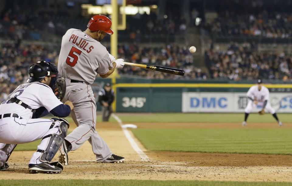 Photo - Los Angeles Angels' Albert Pujols (5) connects for a three-run home run during the sixth inning of a baseball game against the Detroit Tigers in Detroit, Friday, April 18, 2014. (AP Photo/Carlos Osorio)