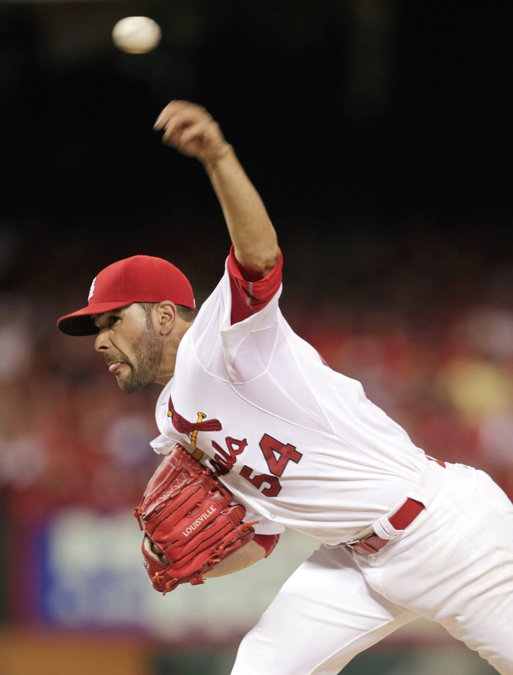 Photo - St. Louis Cardinals starting pitcher Jaime Garcia delivers a pitch in the second inning of a baseball game against the Philadelphia Phillies, Friday, June 20, 2014, in St. Louis. (AP Photo/Tom Gannam)