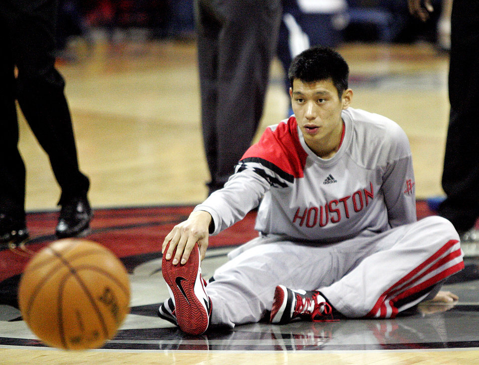 Houston Rockets guard Jeremy Lin stretches before the start of an NBA preseason basketball game against the Oklahoma City Thunder in Hidalgo, Texas, Wednesday, Oct. 10, 2012. (AP Photo/Delcia Lopez) ORG XMIT: TXDL104
