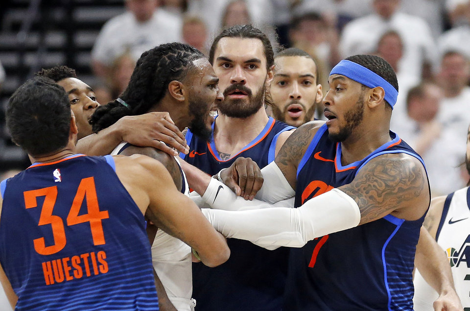 Photo - Utah Jazz forward Jae Crowder, left, and Oklahoma City Thunder forward Carmelo Anthony, right, are separated in the second half during Game 4 of an NBA basketball first-round playoff series, Monday, April 23, 2018, in Salt Lake City. Crowder was ejected from the game. Utah went on to win 113-96. (AP Photo/Rick Bowmer)