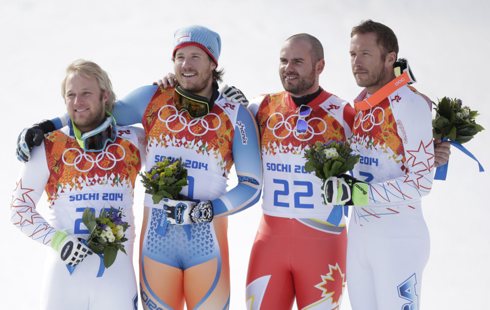 Photo - Men's super-G medalists from left, United States' Andrew Weibrecht (silver), Norway's Kjetil Jansrud (gold), Canada's Jan Hudec (bronze) and United States' Bode Miller (bronze) pose for photographers on the podium for a flower ceremony at the Sochi 2014 Winter Olympics, Sunday, Feb. 16, 2014, in Krasnaya Polyana, Russia.(AP Photo/Charlie Riedel)