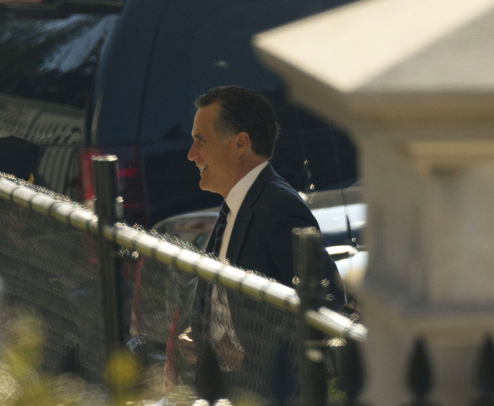 Photo - Former Republican presidential candidate Mitt Romney arrives at the White House in Washington, Thursday, Nov. 29, 2012, for his luncheon with President Barack Obama. (AP Photo/Pablo Martinez Monsivais)