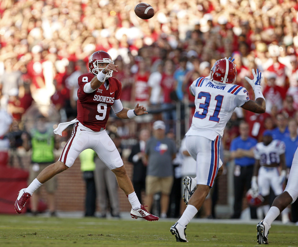 Photo - Oklahoma's Trevor Knight (9) throws over Louisiana Tech's Terrell Pinson (31) during a college football game between the University of Oklahoma Sooners (OU) and the Louisiana Tech Bulldogs at Gaylord Family-Oklahoma Memorial Stadium in Norman, Okla., on Saturday, Aug. 30, 2014. Photo by Bryan Terry, The Oklahoman