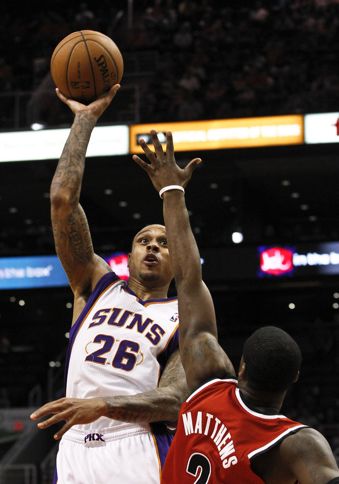 Phoenix Suns' Shannon Brown (26) scores over Portland Trail Blazers' Wesley Matthews during the second half of an NBA basketball game, Wednesday, Nov. 21, 2012, in Phoenix. (AP Photo/Ross D. Franklin)