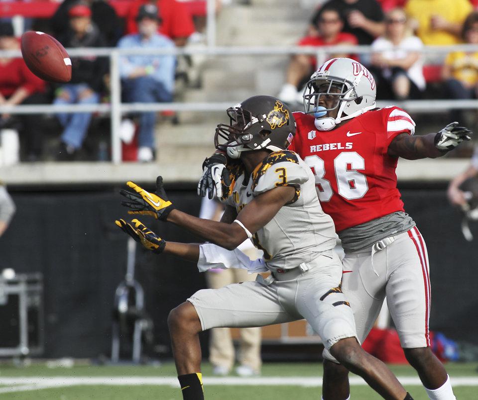 Photo -   UNLV's Sidney Hodge (36) defends against Wyoming's Trey Norman (3) during an NCAA college football game in Las Vegas, Saturday, Nov. 17, 2012. (AP Photo/Las Vegas Review-Journal, Jason Bean) LAS VEGAS SUN OUT; LOCAL TV OUT; LOCAL INTERNET OUT
