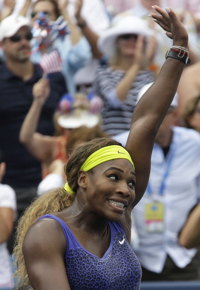 Photo - Serena Williams acknowledges the crowd after defeating Ana Ivanovic, from Serbia, 6-4, 6-1, in a final match at the Western & Southern Open tennis tournament, Sunday, Aug. 17, 2014, in Mason, Ohio. (AP Photo/Al Behrman)