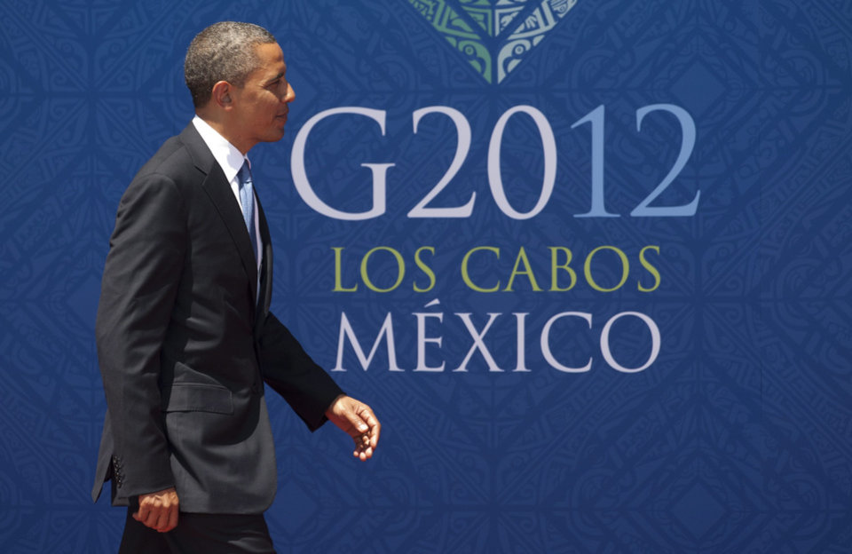 Photo -   President Barack Obama arrives at the G-20 summit in Los Cabos, Monday June 18, 2012. The leaders of the world's largest economies have agreed to step up their efforts to boost growth and job creation, which they call the top priority in fighting the effects of the European economic crisis, according to a draft of the statement to be released Tuesday at the end of the Group of 20 annual meeting. (AP Photo/The Canadian Press, Adrian Wyld)