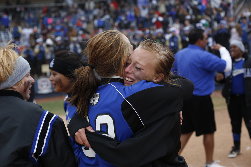Photo - Little Axe's Aspen Vail (5) hugs Ally Allen (23) after winning the 3A OSSAA Championship softball game between against Sequoyah at ASA Hall of Fame Stadium in Oklahoma City, Saturday, Oct. 6, 2012.  Photo by Garett Fisbeck, The Oklahoman