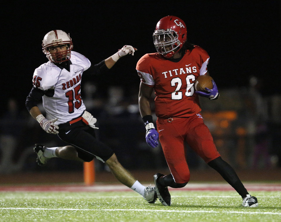 Carl Albert's Dillon Lohr (26) runs from Claremore's Caleb Webster (15) during a high school football game between Carl Albert and Claremore in Midwest City, Friday, Nov. 16, 2012.  Photo by Garett Fisbeck, The Oklahoman