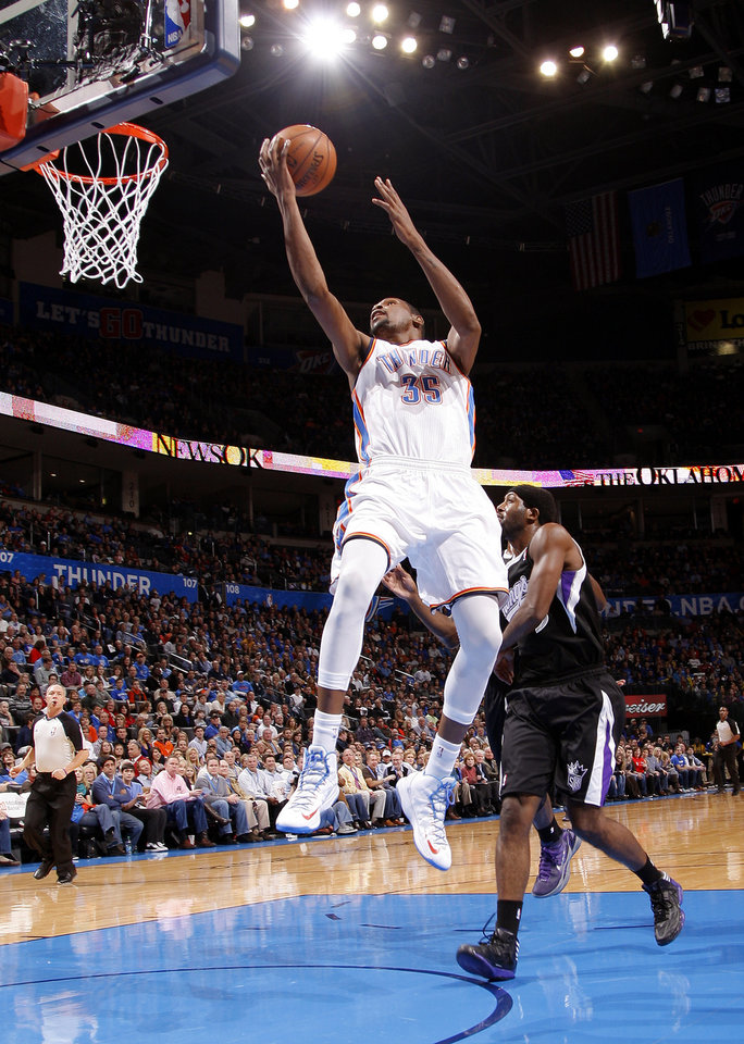 Oklahoma City's Kevin Durant (35) goes to the basket past Sacramento's John Salmons (5)  during an NBA basketball game between the Oklahoma City Thunder and the Sacramento Kings at Chesapeake Energy Arena in Oklahoma City, Friday, Dec. 14, 2012. Photo by Bryan Terry, The Oklahoman