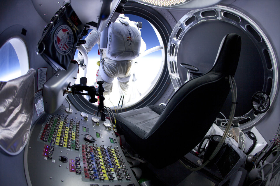 Photo -   In this March 15, 2012, photo provided by Red Bull Stratos, pilot Felix Baumgartner of Austria prepares to jump at the first manned test flight for Red Bull Stratos in Roswell, N.M. On Tuesday, Oct. 9, 2012, if winds allow, in the desert surrounding Roswell, Baumgartner will attempt to break Kittinger's world record for the highest and fastest free fall. (AP Photo/Red Bull Stratos, Jay Nemeth)