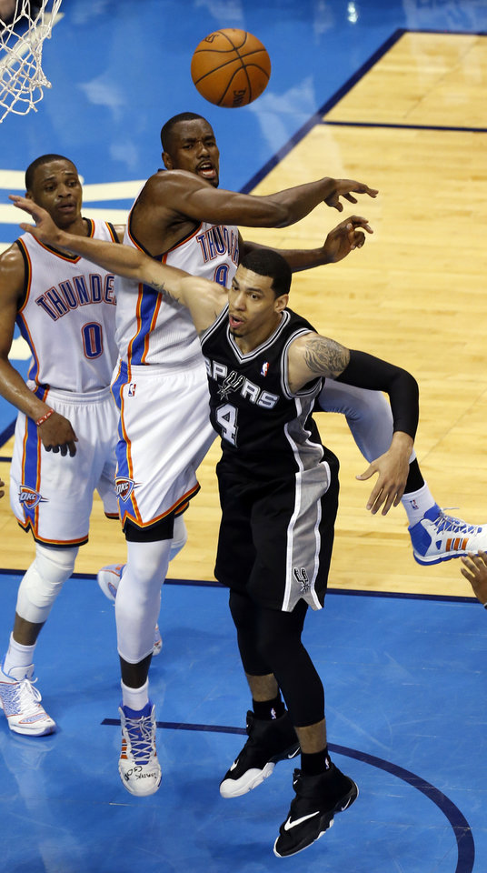 Photo - Oklahoma City's Serge Ibaka (9) blocks San Antonio's Danny Green (4) during Game 3 of the Western Conference Finals in the NBA playoffs between the Oklahoma City Thunder and the San Antonio Spurs at Chesapeake Energy Arena in Oklahoma City, Sunday, May 25, 2014. Photo by Nate Billings, The Oklahoman