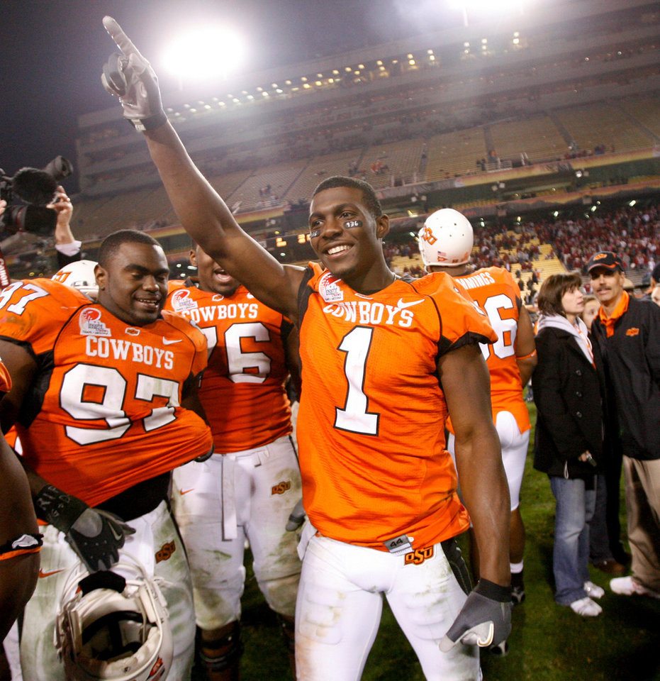 Dez Bryant of OSU celebrates after the Insight Bowl college football game between Oklahoma State University (OSU) and the Indiana University Hoosiers (IU) at Sun Devil Stadium on Monday, Dec. 31, 2007, in Tempe, Ariz. 