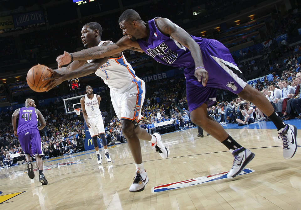 The Thunder\'s Royal Ivey (7) battles for a loose ball with the Kings\' Donte Greene (20) during the NBA basketball game between the Oklahoma City Thunder and The Sacramento Kings on Tuesday, Feb. 15, 2011, Oklahoma City Okla. Photo by Chris Landsberger, The Oklahoman