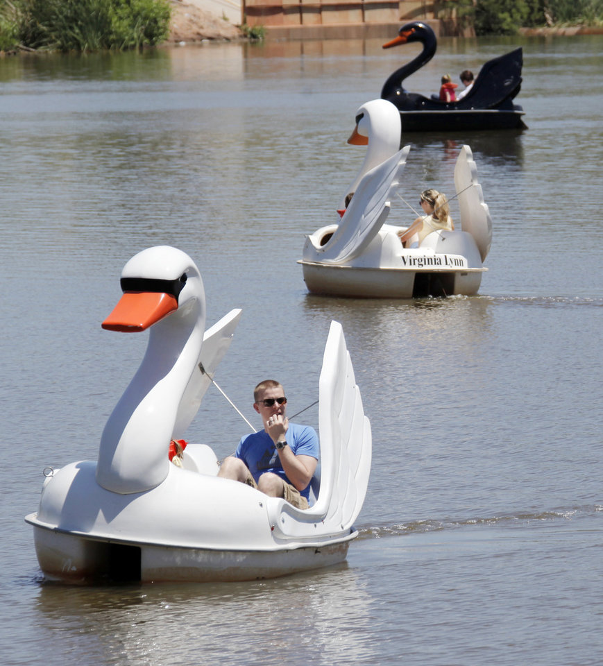 Patrons pilot paddleboats at the Oklahoma City Zoo in Oklahoma City, Friday, May 29, 2009. Photo by Nate Billings, The Oklahoman