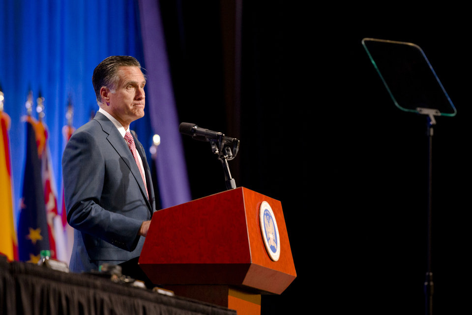 Photo -   Republican presidential candidate, former Massachusetts Gov. Mitt Romney speaks to members of the National Guard Association Convention in Reno, Nev., Tuesday, Sept. 11, 2012. (AP Photo/Scott Sady)