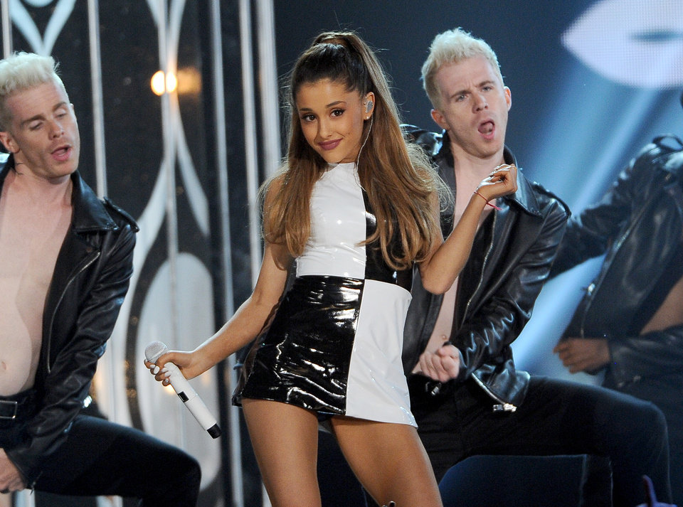 """Photo - FILE - In this May 18, 2014 file photo, Ariana Grande performs at the Billboard Music Awards at the MGM Grand Garden Arena, in Las Vegas. Grande is having a breakthrough in music with the multiplatinum hit """"Problem,"""" which is spending its 13th week in the top 10 on the Billboard Hot 100 chart. The song features rapper Iggy Azalea and is from Grande's sophomore album, """"My Everything,"""" to be released Aug. 25, 2014.  (Photo by Chris Pizzello/Invision/AP, file)"""