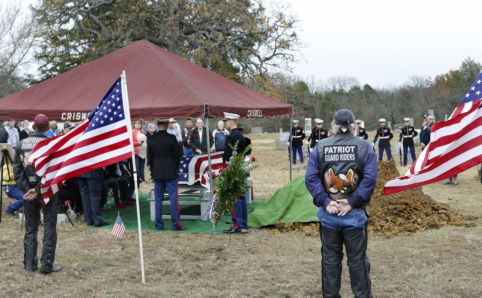 Photo -  Relatives were joined by veterans groups Thursday afternoon in a small cemetery in rural Pontotoc County to bury the remains of U.S. Marine Pvt. Vernon Keaton who was killed aboard the USS Oklahoma when it was attacked by Japanese warplanes at Pearl Harbor on Dec. 7, 1941. His remains were recently identified and flown back to Oklahoma earlier this week. [Photo by Jim Beckel, The Oklahoman]