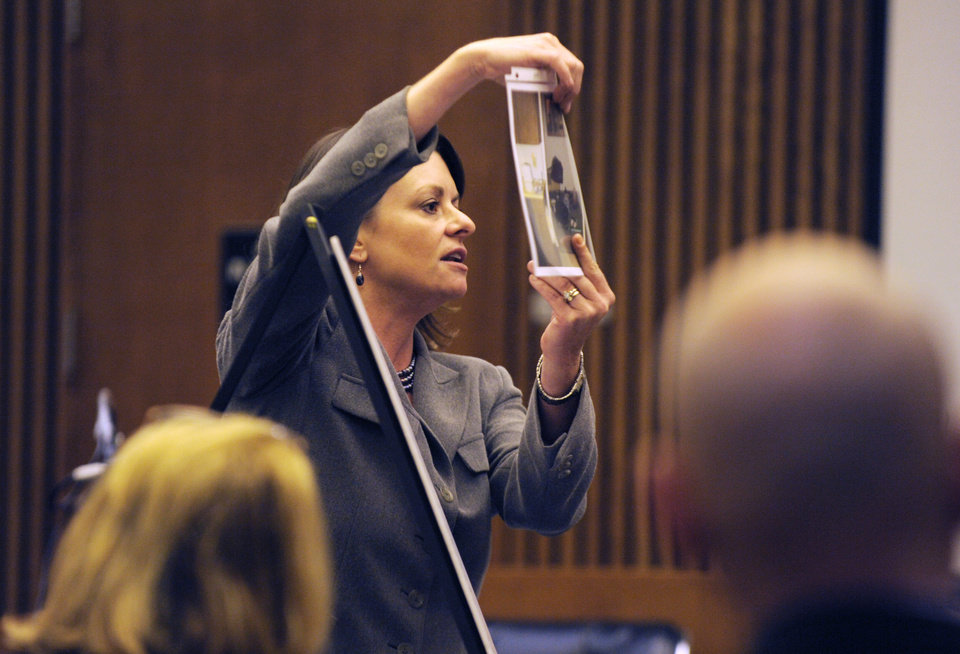 Photo - Defense attorney Cheryl Carpenter holds a photo during closing arguments Wednesday, Aug. 6, 2014, in Detroit in the trial of Theodore Wafer. The case of Waffen, a suburban Detroit homeowner who opened his front door and blasted an unarmed woman on his porch, has gone to the jury. Wafer, an airport maintenance worker who lives alone, is charged with second-degree murder and manslaughter in the death of 19-year-old Renisha McBride. (AP Photo/Detroit News, Clarence Tabb Jr.)