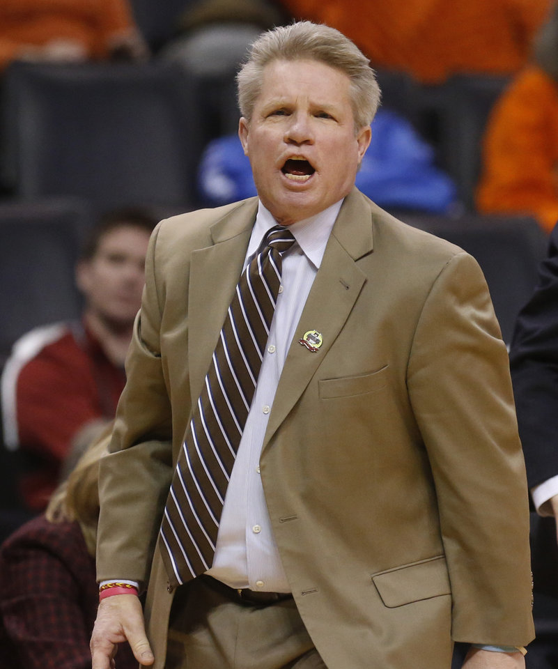 Photo - Iowa State head coach Bill Fennelly shouts in the second half of an NCAA college basketball game in the quarterfinals of the Big 12 Conference women's college tournament in Oklahoma City, Saturday, March 8, 2014. Oklahoma State won 67-57. (AP Photo/Sue Ogrocki)