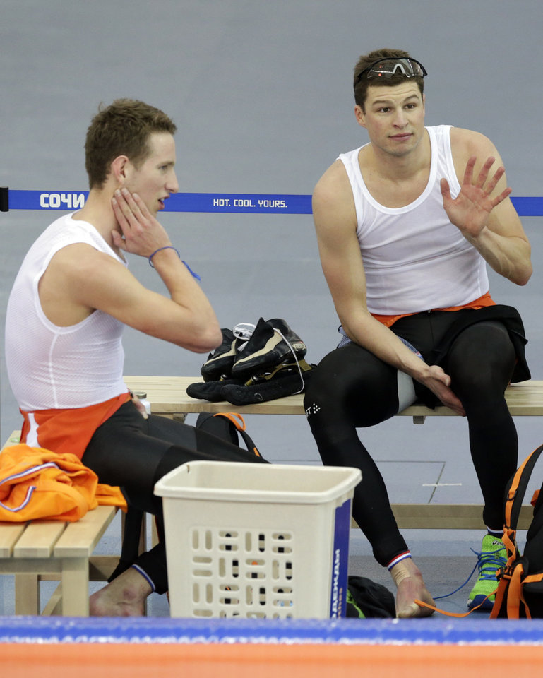 Photo - Sven Kramer of the Netherlands, right, waves as teammate Jan Blokhuijsen sits beside him after the men's speedskating team pursuit semifinals at the Adler Arena Skating Center at the 2014 Winter Olympics, Friday, Feb. 21, 2014, in Sochi, Russia. (AP Photo/Matt Dunham)