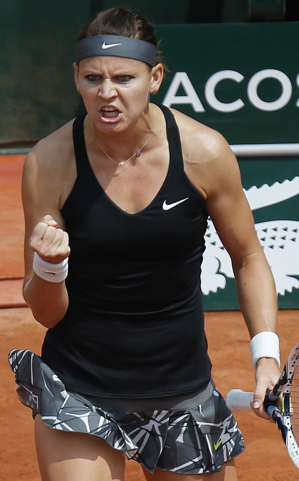 Photo - Lucie Safarova of the Czech Republic reacts after a winning point as she plays Serbia's Ana Ivanovic during their third round match of  the French Open tennis tournament at the Roland Garros stadium, in Paris, France, Saturday, May 31, 2014. (AP Photo/David Vincent)