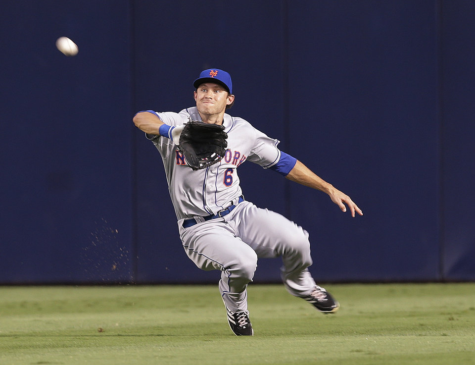 New York Mets center fielder Matt den Dekker makes the catch to retire Atlanta Braves batter Justin Upton in the second inning of a baseball game Tuesday, Sept. 3, 2013 in Atlanta. (AP Photo/John Bazemore)