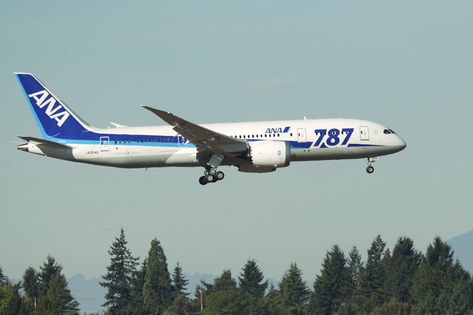 A Boeing 787 operated by All Nippon Airways comes in for a landing at Seattle-Tacoma International Airport, Monday, Oct. 1, 2012, on the first day of service for the 787 on ANA's Seattle-Tokyo route. (AP Photo/Ted S. Warren)