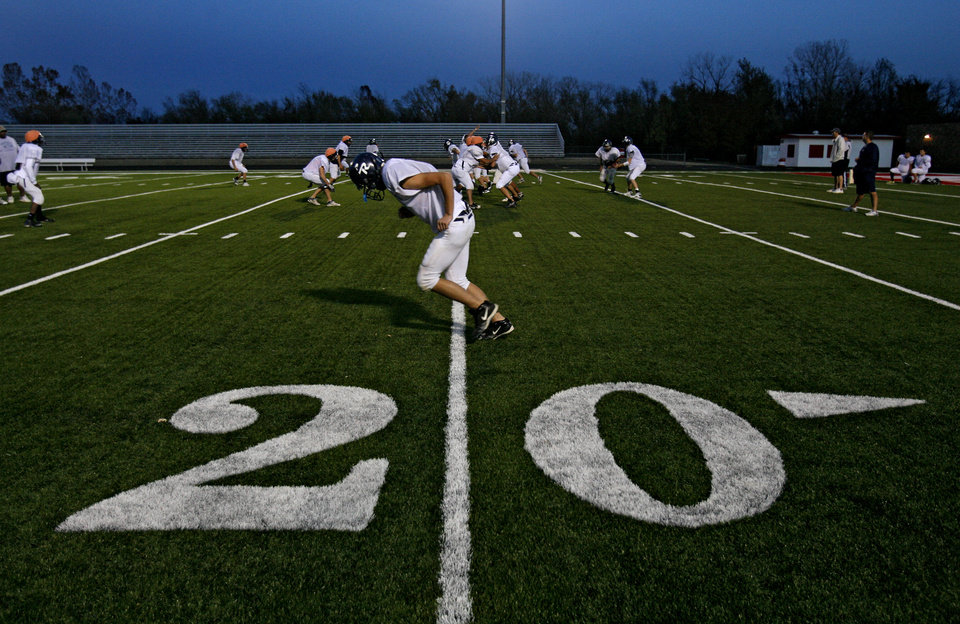 The El Reno High School football team practices at Yukon High School on Tuesday, Nov. 25, 2008, in Yukon, Okla. El Reno was getting some practice time on the artificial turf before playing this week's semifinal playoff game at Mustang High School.   STAFF PHOTO BY CHRIS LANDSBERGER  ORG XMIT: KOD