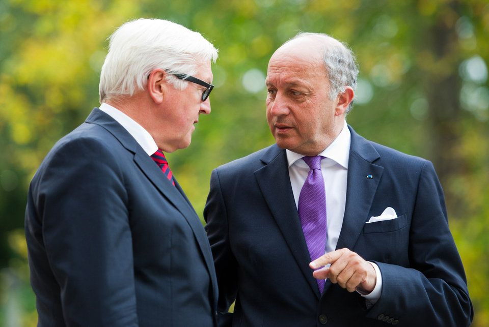 Photo - German Foreign Ministers Frank-Walter Steinmeier, left, talks to his French counterpart Laurent Fabius talk before a meeting with the Foreign Ministers of Ukraine and Russia at the Guesthouse of the Foreign Ministry Villa Borsig in Berlin, Sunday, August 17, 2014. (AP Photo/Steffi Loos)