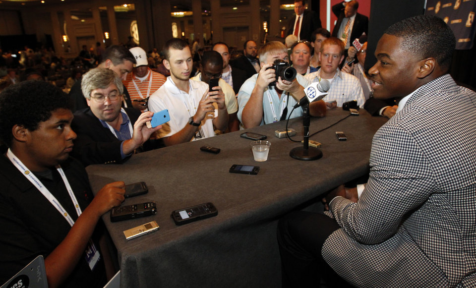 Photo - Alabama wide receiver Amari Cooper speaks to the media at the Southeastern Conference NCAA college football media days Thursday, July 17, 2014, in Hoover, Ala. (AP Photo/Butch Dill)