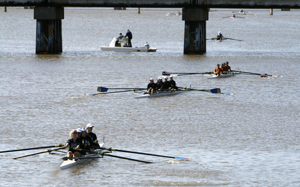 Photo - Teams move their rowing shells toward the starting line during the Oklahoma Regatta Festival on the Oklahoma River in Oklahoma City, OK, Saturday, October 5, 2013,  Photo by Paul Hellstern, The Oklahoman
