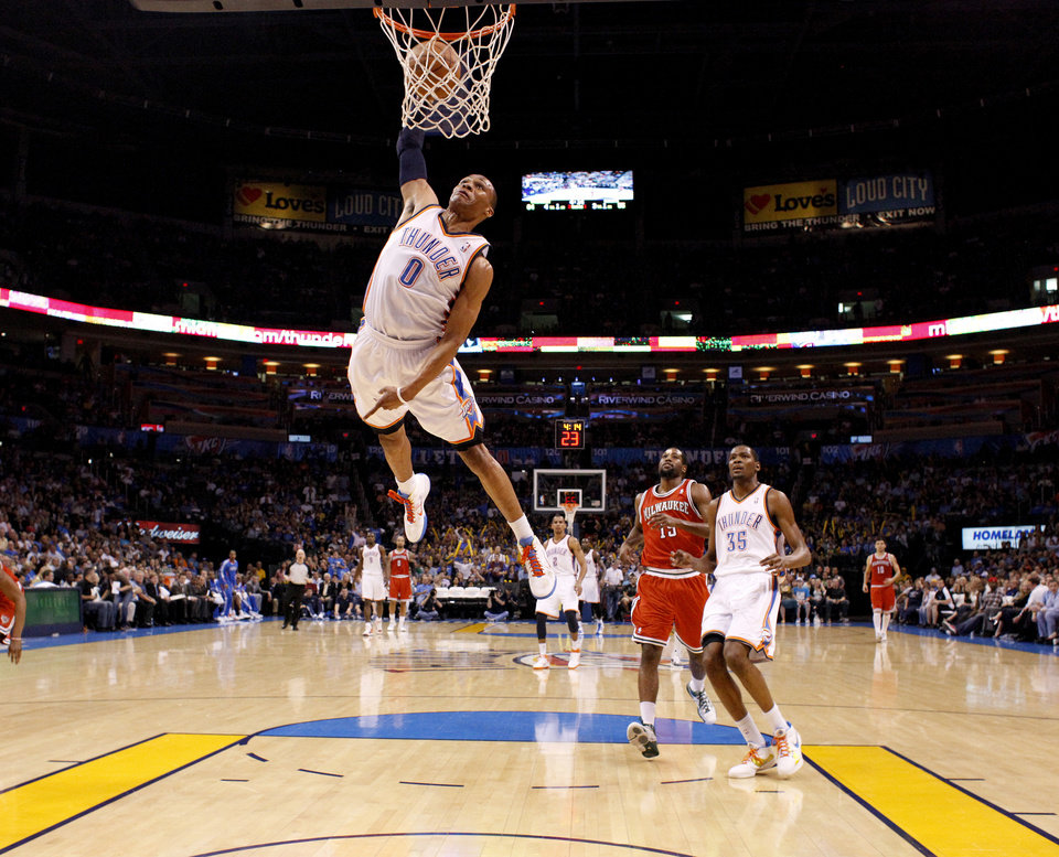 Oklahoma City\'s Russell Westbrook (0) dunks the ball during the NBA basketball game between the Oklahoma City Thunder and the Milwaukee Bucks at the Oklahoma City Arena, Wednesday, April 13, 2011. Photo by Bryan Terry, The Oklahoman