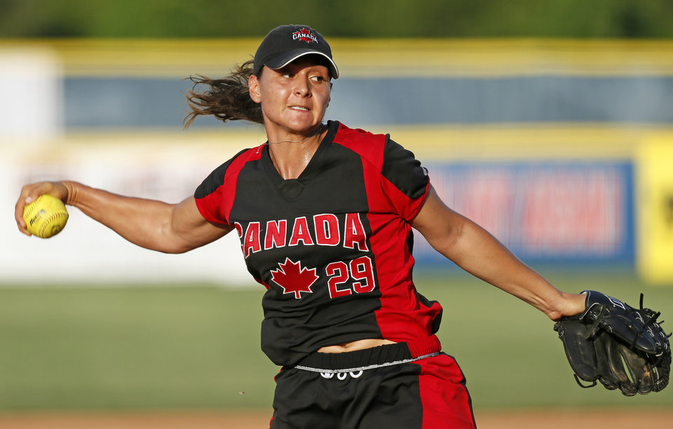 Photo - Jenna Caira (29) pitches for Canada during a game between Team USA and Canada in the World Cup of Softball at ASA Hall of Fame Stadium in Oklahoma City, Thursday, July 11, 2013. Team USA won 7-0 in 6 innings. Photo by Nate Billings, The Oklahoman