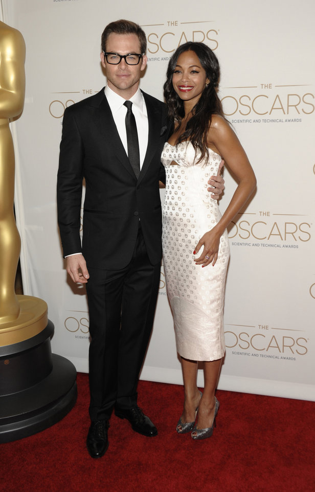 Actor Chris Pine, left, and actress Zoe Saldana arrives at The Academy of Motion Picture Arts and Sciences, Scientific and Technical Awards at The Beverly Hills Hotel in Beverly Hills, Calif. on Saturday, Feb. 9, 2013. (Photo by Dan Steinberg/Invision/AP)