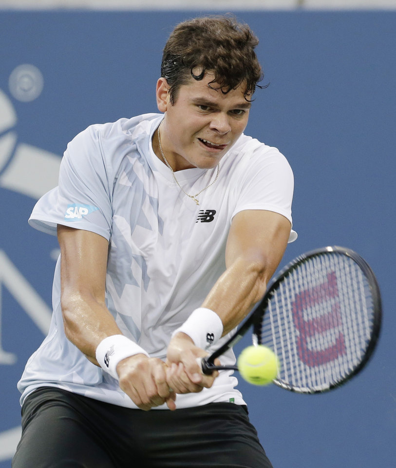 Milos Raonic, of Canada, returns a shot to Richard Gasquet, of France, during the fourth round of the 2013 U.S. Open tennis tournament, Monday, Sept. 2, 2013, in New York. (AP Photo/Mike Groll)