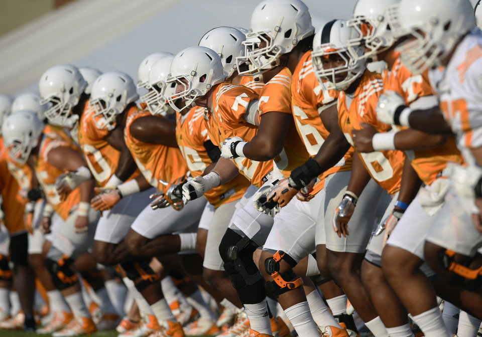 Photo - University of Tennesse players line up for stretching exercises during the first football practice at Haslam Field, Friday, Aug. 1, 2014 in Knoxville, Tenn. (AP Photo/The Knoxville News Sentinel, Amy Smotherman Burgess)