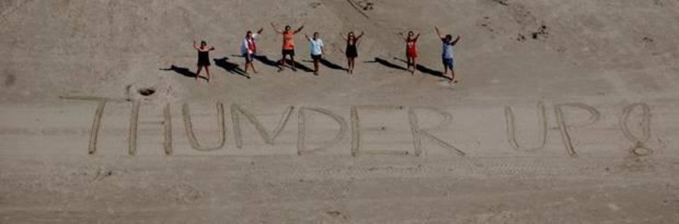 The Rodwell family from Oklahoma City shows their Thunder pride on family vacation in Galveston, Texas.