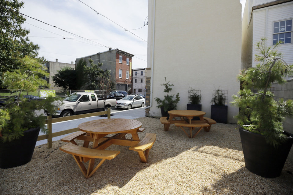 Photo -   A vacant lot owned by the Philadelphia Redevelopment Authority is shown, Thursday, Sept. 20, 2012, in Philadelphia. Ori Feibush, a real estate developer, has turned a trash-strewn city-owned lot, vacant for roughly 30 years, into a welcoming spot for customers of his month-old corner cafe. But city officials say Feibush shouldn't have done work on a lot he doesn't own or rent, shouldn't be using taxpayer-owned property to benefit his business. (AP Photo/Matt Slocum)