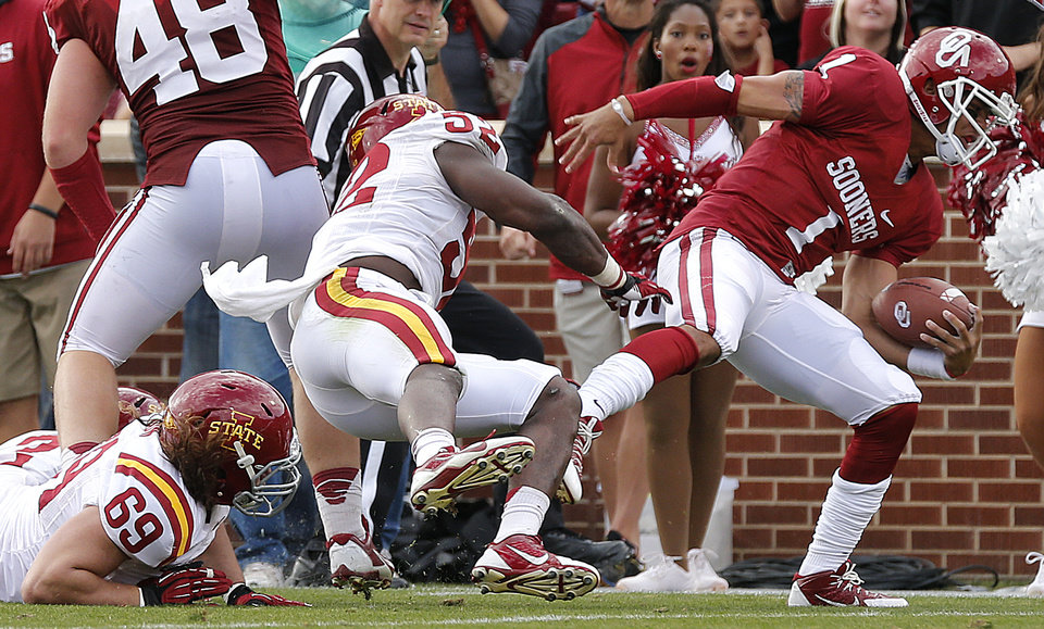 Oklahoma's Kendal Thompson (1) is forced out of bounds by Iowa State's Jeremiah George (52) during the college football game between the University of Oklahoma Sooners (OU) and the Iowa State University Cyclones (ISU) at Gaylord Family-Oklahoma Memorial Stadium in Norman, Okla. on Saturday, Nov. 16, 2013. Photo by Chris Landsberger, The Oklahoman