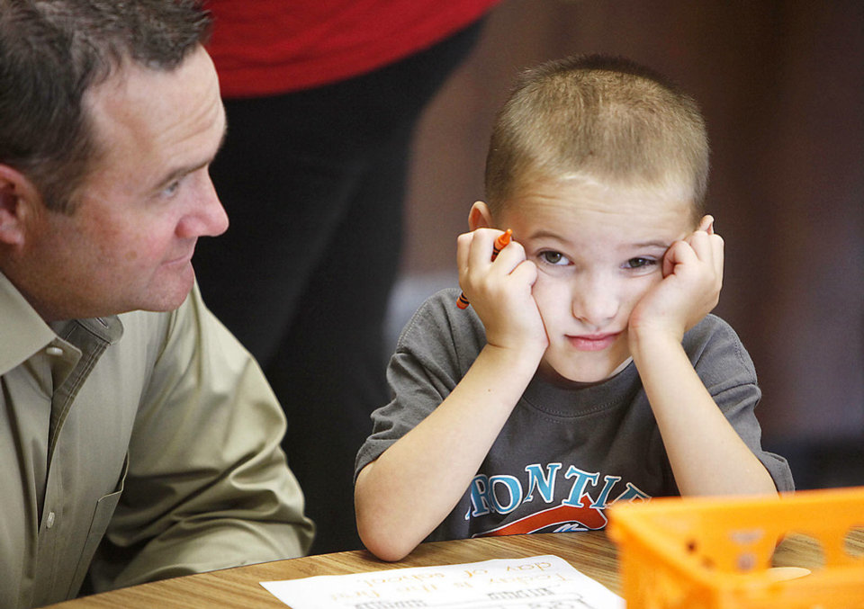 Photo - Shawn Roberson says goodbye to his son  Zac, 6, as Edmond Schools begins classes for the new school year at Frontier Elementary School in Edmond, OK, Tuesday, August 20, 2013,  Photo by Paul Hellstern, The Oklahoman