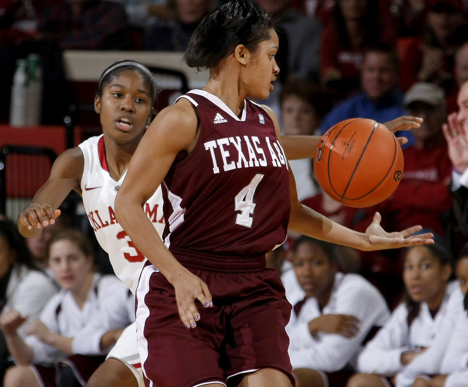 Photo - OU's Aaryn Ellenberg (3) defends Texas A&M's Sydney Carter (4) during the Big 12 women's basketball game between the University of Oklahoma and Texas A&M at Lloyd Noble Center in Norman, Okla., Wednesday January 26, 2011.  Photo by Bryan Terry, The Oklahoman