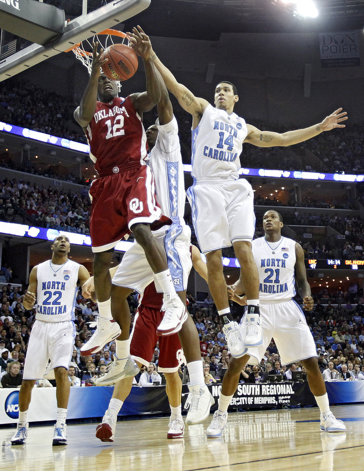 Photo - Oklahoma's Juan Pattillo (12) battles for a rebound with North Carolina's Danny Green (14) during the second half in the Elite Eight game of NCAA Men's Basketball Regional between the University of North Carolina and the University of Oklahoma at the FedEx Forum on Sunday, March 29, 2009, in Memphis, Tenn.