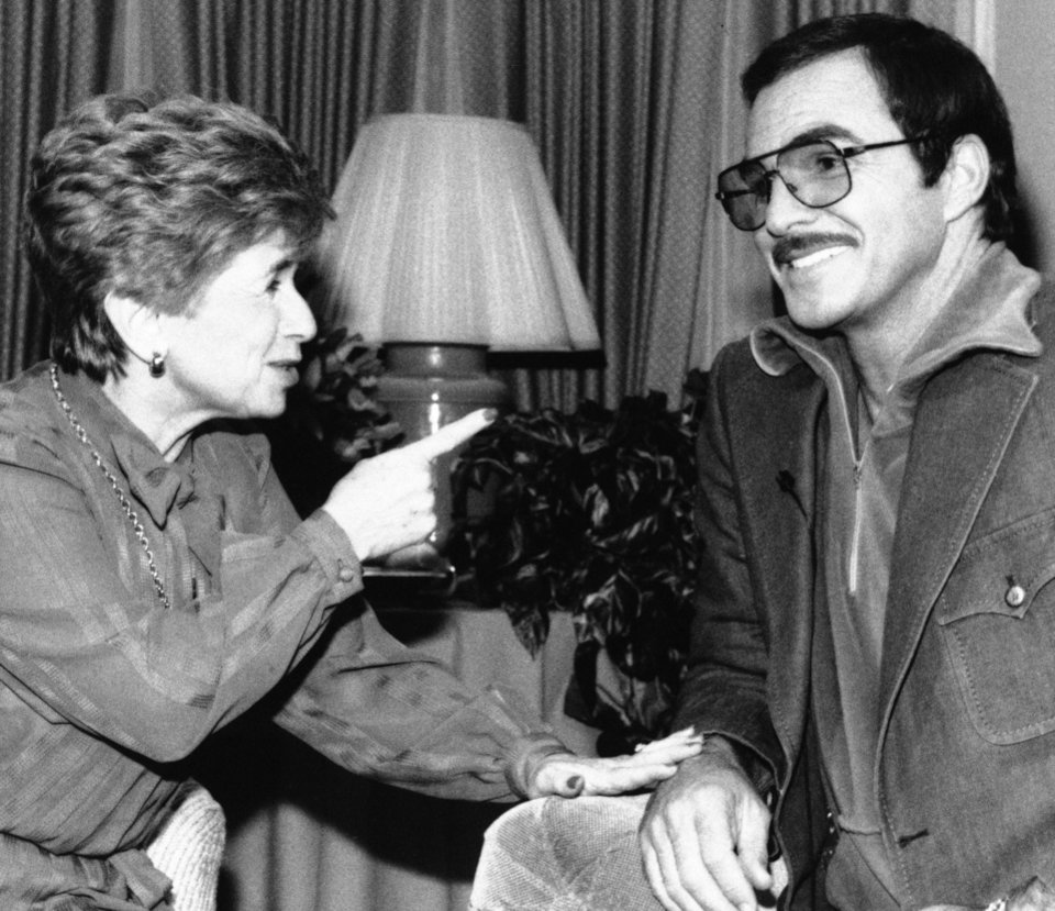 Photo -   FILE - In this Dec. 13, 1984 file photo, sex therapist Dr. Ruth Westheimer speaks with actor Burt Reynolds on the Lifetime channel's