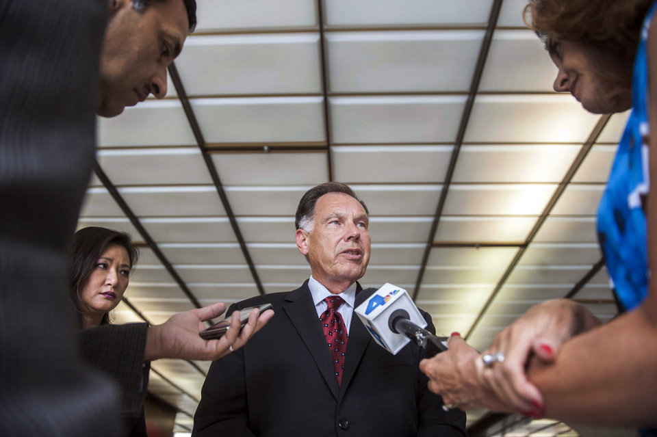 Photo - Orange County District Attorney Tony Rackauckas speaks at an informal news conference after a hearing at the Santa Ana Courthouse in Santa Ana, Calif., Wednesday, July 10 2013. 42-year-old Saudi princess Meshael Alayban has been charged with human trafficking for allegedly holding a domestic worker against her will at a California condominium, prosecutors said. (AP Photo/The Orange County Register, Stuart Palley)   MAGS OUT; LOS ANGELES TIMES OUT