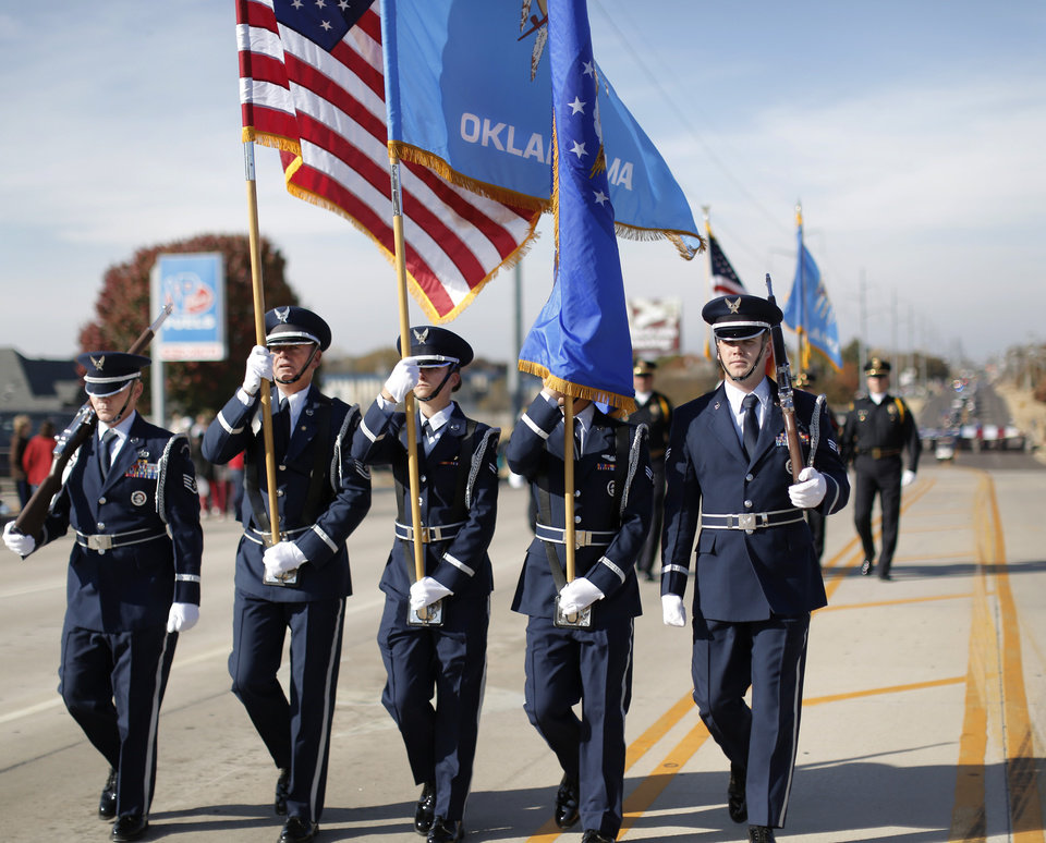 Photo - An Air Force color guard from Tinker AFB leads the Midwest City Veteran's Day Parade on Friday, Nov. 10, 2017. Photo by Jim Beckel, The Oklahoman
