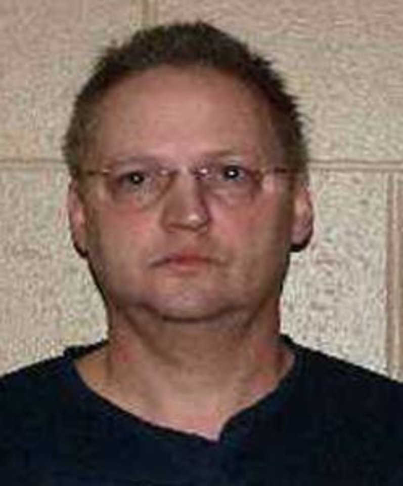 Photo - FILE - This undated file photo released by the U.S. Marshal's office shows accountant Rick D. Snow. U.S. District Judge Jane Magnus-Stinson is set to sentence Snow,  Tim Durham, and James Cochran following their June convictions on fraud and conspiracy charges on Friday, Nov. 30, 2012. The three were convicted of swindling investors out of about $200 million. (AP Photo/ U.S. Marshal's Office)