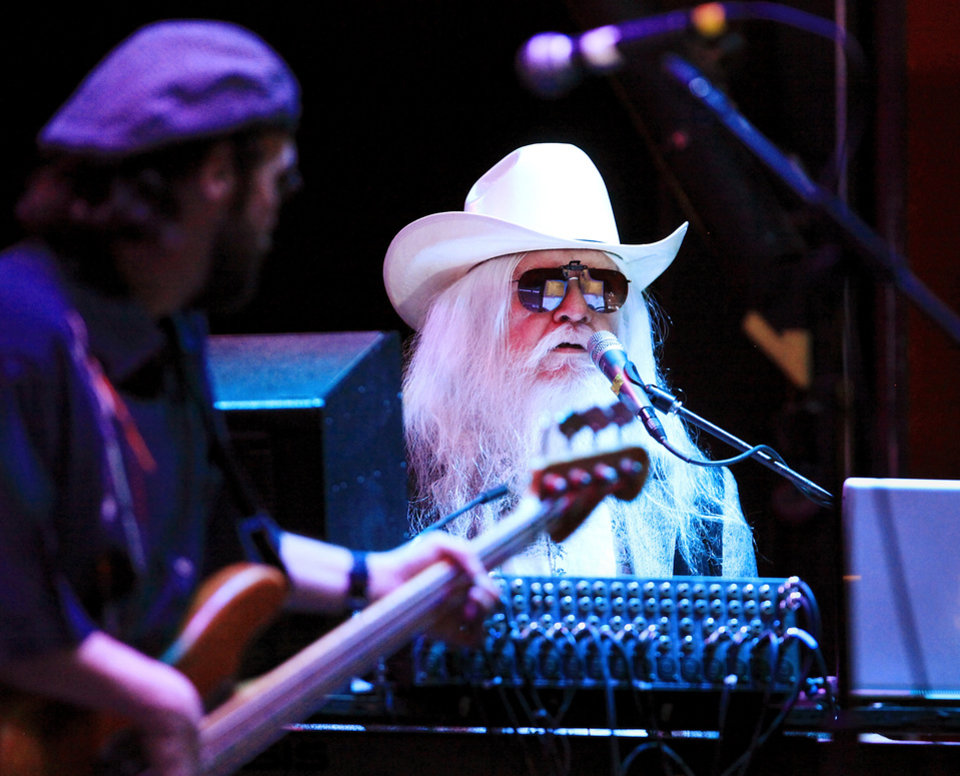 Photo - Tulsa musician and recording artist Leon Russell thrilled an energized audience for a little more than an hour Sunday night, April 25, 2010, when he performed on the Jaegermeister stage at Norman's Music Festival in downtown Norman. Several people