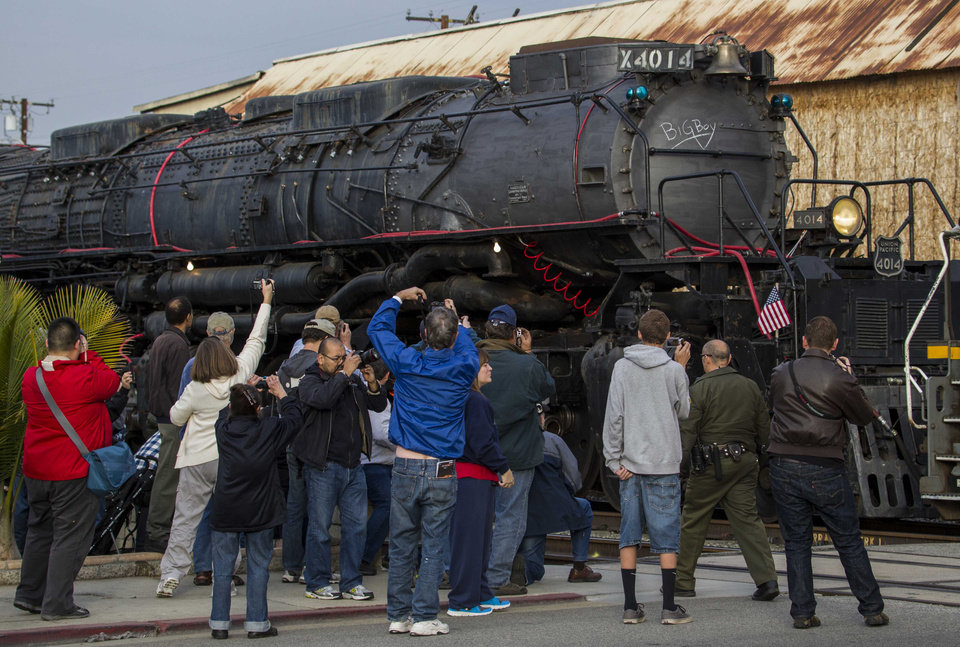Photo - File - In this Jan. 26, 2014 file photo, spectators take pictures the historic locomotive, Union Pacific Big Boy No. 4014 at Metrolink Station in Covina, Calif. The locomotive was to head for Colton over the next several weeks before No. 4014 is towed to Union Pacific's Heritage Fleet Operations headquarters in Cheyenne, Wyo. (AP Photo/Ringo H.W. Chiu, file)